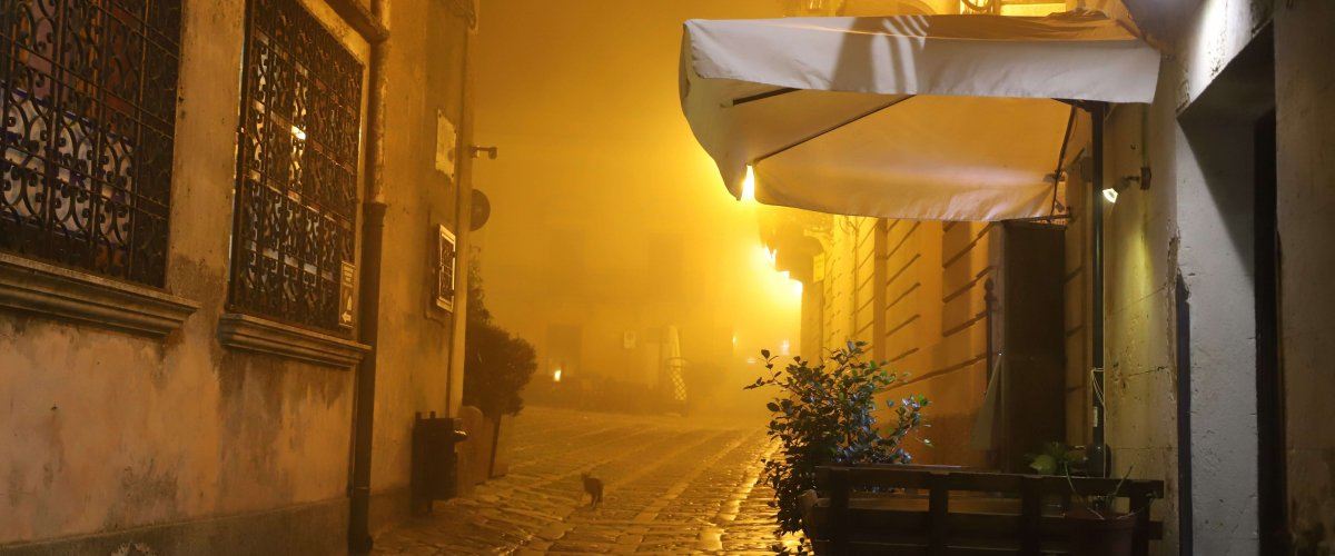 Cobblestone street and fog in Erice, Sicily
